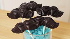 Watch nerdy nummies on YouTube to lean how to make moustache candy pops!!!
