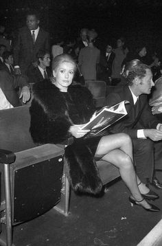 Catherine Deneuve at a James Brown concert in Paris, wearing a fur coat with stockings and ankle strap heels. Catherine Deneuve, Belle Lingerie, Celebrities In Stockings, Photos Rares, Vintage Stockings, Carine Roitfeld, Stocking Tops, James Brown, French Actress