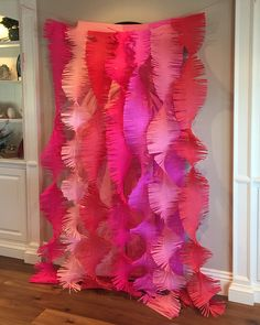 Fringed cut crepe paper for a beautiful photo backdrop!
