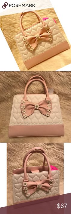 """Betsey Johnson / Satchel Flirty Floral Cream Betsey Johnson. Pink & Cream Satchel. """"Flirty Floral"""". With Decorated Bow & Quilted Hearts. Large Pink Bow on Front with Daisy Flower Details ... Betsey Johnson Bags Satchels"""