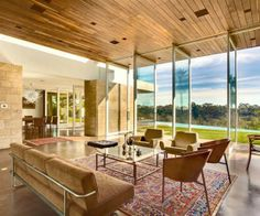 Persian rug in modern living room.  Interior Design, Charming Modern Living Room Design With Glass Door Design And Persian Style Rugs Design Design Ideas: Make Your House Look ...