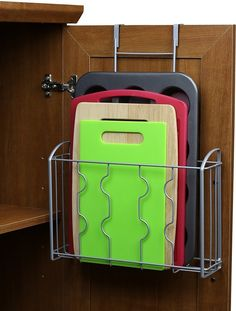 Finally have a place for all those large flat cooking tools with a basket you can hang inside your cabinet. | 47 Storage Ideas That Will Organize Your Entire House