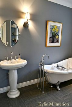 The Most Popular Benjamin Moore Earth Toned Paint Colours : Accent / Feature Walls - Kylie M Interiors. Shown here is Dior Gray which is a gray with purple undertones in a powder room with clawfoot tub