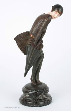 "A beautiful and very rare Art Deco  French bronze and ivory figure by Claire-Jean Roberte Colinet, ""The Squall"" circa 1925."