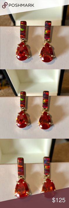 "Dazzling Solid Silver Fire Opal Earrings. These silver earrings will set your look ablaze with a rectangular raw Fire Opal on top and a 1/4"" Teardrop Faceted Fire Opal dangling below. It's truly spectacular how these earrings catch the light to set them ablaze with color! Jewelry Earrings"