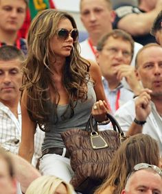 Pin for Later: Victoria Beckham's 45 Most Fabulous Moments in a Pair of Sunglasses To Sit Pretty at All of David's Soccer Games