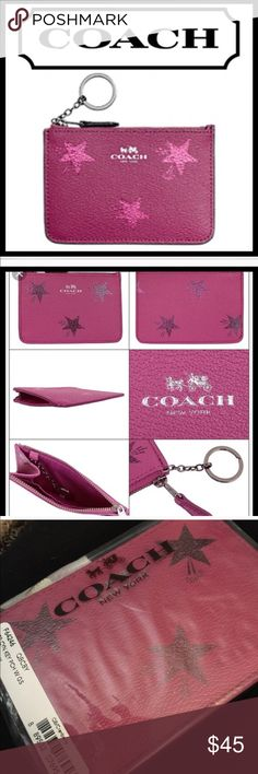 """Coach Wristlet Cranberry Cross grain leather with cranberry metallic stars Zipper Top Closure with Cranberry leather zip pull Coach emblem embossed on front 2"""" polished link chain with a 1 1/2"""" split key ring attached to interior Gunmetal hardware Measures approx 5"""" L x 3 3/4""""H Cranberry sateen interior 1 Multi-Function Interior Pocket MSRP: $65 🔲ALL MY COACH PRODUCTS COME STRAIGHT FROM COACH AND HAVE NEVER BEEN HANDLED BY ANYONE & WILL COME TO YOU WRAPPED IN ITS ORIGINAL PACKAGING 🔲 Coach…"""