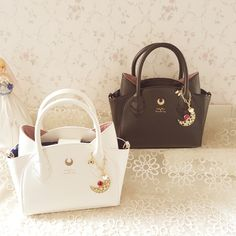 Material: made of artificial PU leather Color: Black/White Option: Bigger One/ Smaller One Size Reference for Bigger Bag: Height: Width: Thickness: ? Size Reference for Smaller Bag: Height: Width: Thickness: If you want the?pendant, you can get it here Sailor Moon Cat, Sailor Moon Crystal, Luna And Artemis, Kawaii Bags, Kawaii Stuff, Big Bags, Cosplay, Designer Handbags, Designer Purses