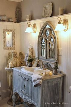 Shelving around the top of a room for objects of interest. Interesting mirror from an ornate window. Sink mounted in an old piece of furniture.