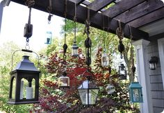 outdoor hanging lanterns. I have collected several old block and tackle sets and have been wanting to do something similar. But I would really like to incorporate low voltage lighting; I wonder if you could thread it through thick rope?