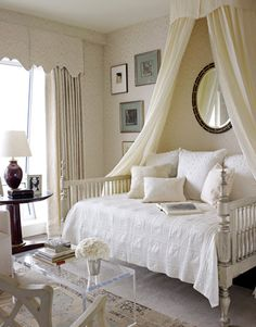 Phoebe Howard for HOUSE BEAUTIFUL in NYC  Canopy Bed--this is one of my favorite rooms the Howards have designed.  Wall fabric and curtains, Mark Alexander by Romo's Jahangir. Bed by Jim Howard. Bedding by Wamsutta.