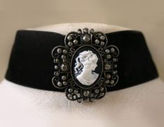 CAMEO PIN IN AN ANTIQUE SETTING ON BLACK VELVET. CLASP IN BACK $24.95   My mom used to have one very similar back in the early 70's. I loved it and had it for years. I don't know where it has disappeared....