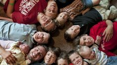 In this Aug. 6, 2013 photo, the 12 Schwandt brothers pose for a photograph in their home in Rockford, Mich. Clockwise from bottom left are: Tyler, 21, holding Tucker, 2 days;  Vinny, 10; Drew, 16; Zach, 17; Charlie, 3; Calvin, 8; Brandon, 14; Luke, 19 months; Gabe, 6; Wesley, 5 and Tommy, 11. Parents Jay and Kateri Schwandt are expecting a baby on Saturday, May 9, 2015, a day before Mother's Day, and they're sticking to their tradition of not finding out in advance whether they're having a…
