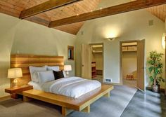 Warm wooden bedroom decor and ceiling