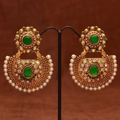 Anvi's beautiful ball work bridal ear danglers studded with emeralds, white stones and polki ear pearls