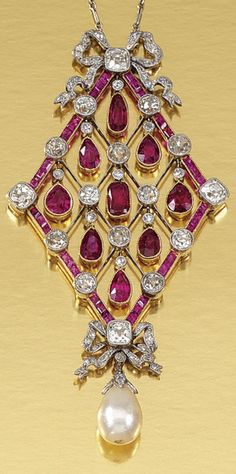 AN EDWARDIAN RUBY, PEARL AND DIAMOND PENDANT NECKLACE, CIRCA 1910. The openwork lozenge-shaped pendant designed as a knife-edge lattice millegrain-set with circular-, single-cut and cushion-shaped diamonds and articulated pear-shaped rubies, suspending a diamond capped pearl drop, embellished by two tied ribbon motifs highlighted by rose- and single-cut diamonds. #Edwardian #pendant
