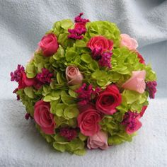 Hand tied bouquet of green hydrangeas, pink roses, pink sinensis.