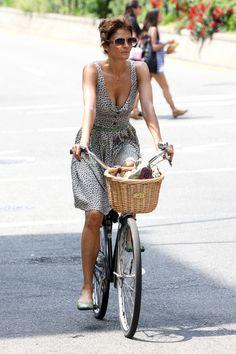 Helena Christensen doing the sexy bike thing.