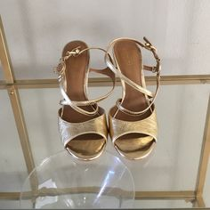 COACH Sandal Heels Never Worn Leather upper. Crossover straps with an adjustable buckle closure. Side harness with metal brand logo detail. Open toe with a stiletto heel. Leather insole and lining. Leather outsole. Imported. Heel Height: 4 in Coach Shoes Sandals