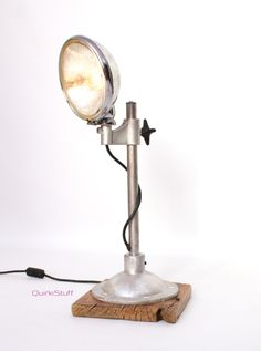 Vintage Headlight Lamp...light is a vintage Lucas car headlight, stand is from an old medical device & the base is a 200+ year old piece of wood salvaged from a church in Dublin.