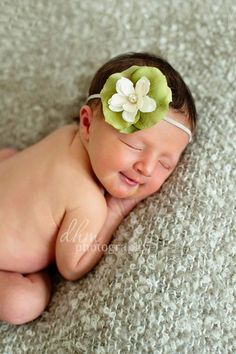 Newborn Photography. Baby smiles