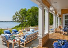 Porch. Coastal Porch. Coastal Porch and Patio. Shingle home porch. Shingle home patio. Coastal Home Porch. Coastal Home Patio. This backyard shows what a dream of having a beach house is all about... you can feel the serenity and beauty of this place. #Porch #Patio #Coastal #CoastalHome #ShingleHome SLC Interiors.