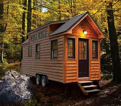 "This tiny house is built by Tiny Home Builders out of Cumming, Georgia and it embodies everything we love about the Tiny House Movement. This is the ""Tiny Living"" model from the builders and it comes in 12 foot, 16 foot, or lengths. Building A Tiny House, Tiny House Plans, Tiny House On Wheels, Building Homes, Tiny House Movement, Tiny House Living, Tiny House Design, Cabins In The Woods, Little Houses"