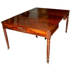Salem Classical Samuel Field McIntire Mahogany Dining Table  c. 1820  Finest Cuban cathedral-grained mahogany, with later internal extension railing system attached to the pair of matching center support legs. [Federal]