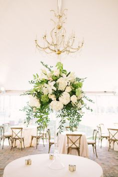 Glamorous and elegant centerpiece: http://www.stylemepretty.com/2014/09/23/a-classic-southern-wedding-at-the-merrimon-wynne-house/ | Photography: Kristin Moore - http://www.kristinmoorephoto.com/
