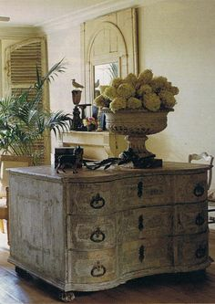 Taupe-gray, bow front, ball footed Belgian dresser
