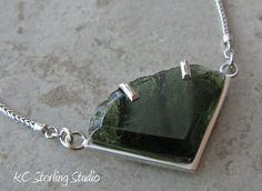 Natural moldavite and sterling silver metalsmithed necklace. $200.00, via Etsy.