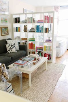 for Dividing a Studio Apartment Jacqueline Clair uses an Ikea bookshelf as a divider in her Upper East Side studio apartment.Jacqueline Clair uses an Ikea bookshelf as a divider in her Upper East Side studio apartment. Studio Apartment Divider, Studio Apartment Living, Studio Apartment Layout, Studio Apartment Decorating, Studio Living, Living Room, Studio Layout, Studio Design, Interior Design Studio