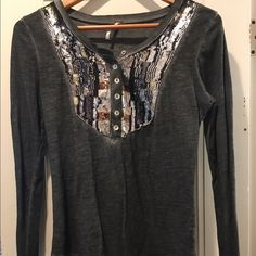 Free People sequined shirt Long sleeve sequined tee. Great to dress up or down. Excellent condition aside from rip on tag. Free People Tops