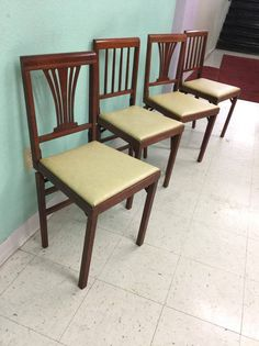The mahogany cherry paddle folding chairs.