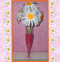 Bouquet de marguerites immortelles avec pots de yaourts blanc http://nounoudunord.centerblog.net/1099-bouquet-de-marguerite-immortelles