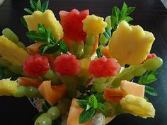 Fruit flower bouquet made using cookie cutters/placing fruit on wooden skewers.