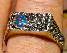 Mens ring. Vivid Fire Opal ring. Genuine Australian Black Opal.7x5mm Gemstone.Sterling Silver designer setting. SIZE 11