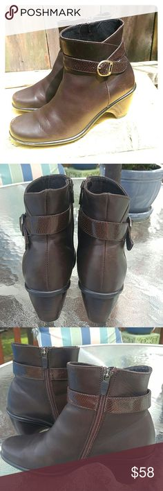 Dansko Brown Leather Ankle Boots Brown ankle boots from Dansko with cute buckle and trim. These are real leather, not man-made material. If you've ever worn Dansko you know they are a comfortable, well-made shoe! Very good used condition. There is a mark on the right toe. It's on the sole, not the leather. It will come off with cleaning. Minor scratches on the buckles. A very nice, cute boot! Dansko Shoes Ankle Boots & Booties