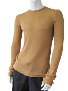 Roundnecked pull in 100% cotton  Long roundnecked sweater  with bordered seam back, tubular at the bottom and the sleeves. $159.00