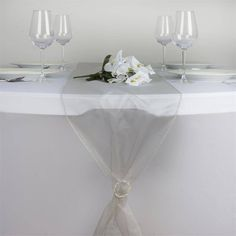 Silver Organza Table Runner | Beautiful and charming crystal organza runners are a real treat to eyes and big attention grabbers. Add that sophisticated touch of chic elegance into your event's décor with our splendid sheer organza runners. Made from premium quality nylon, these runners will impart an impeccable sheen and glossy luster to your plain reception or wedding tables, creating that super WOW factor you so eagerly want to attain. Spread these atop your plain or colorful table linens…
