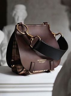 Equestrian-inspired and versatile, This Burberry Bridle Bag from the runway is made from soft leather and Haymarket check panels, and finished with utilitarian clasps. Carry it two ways: crossbody or over the shoulder. Beautiful Handbags, Beautiful Bags, Fashion Handbags, Fashion Bags, Women's Handbags, My Bags, Purses And Bags, Designer Purses And Handbags, Cute Bags