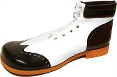 Black and white saddle-type clown shoes with 3 red stars on the toe area. Great look! One size fits most. saddle type shoe with red stars on toe area. Clown Shoes, Clowning Around, Combat Boots, Wings, Sneakers Nike, Pairs, Black And White, Clowns, Drawing