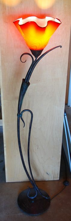 floor lamp, hand blown glass by artist rick strini, hand forged iron with a bronze patina by Germany manufacturer Robers  call now for sale.