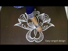 Easy freehand rangoli designs || lotus muggulu || simple kolam with out dots - YouTube