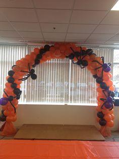 LLC Halloween balloon arch with balloon spiders.