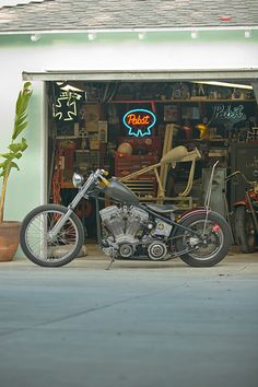 would kill for a garage and bike like this