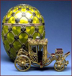 Faberge: The Coronation Egg.  At the top of the egg is the crowned monogram of Tsarina Alexandra Feodorovna emblazoned in rose-cut diamonds and rubies. The date 1897, appears beneath a smaller portrait diamond at the bottom of the egg. When the egg is opened, the surprise fitted inside a velvet-lined compartment is a removable replica of a coach of gold, enamel, diamond and rock crystal.
