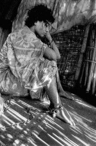 Mental Health and Development | United Nations | Image of woman in hut who is chained to the floor. WHO image by Muhammed entitled Unchained Soul