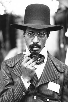 "IKE TURNER (1931 - 2007). ""A pipe in the mouth makes it Clear that there has been no mistake. You are undoubtedly a man"". (Quote: A.A. Milne)"