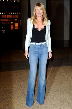 Ellen Pompeo wears high waisted boot-cut jeans. The high waist draws the eye up and lengthens the legs. The boot-cut balances out wider hips. The top is tucked in to manipulate the waist line.